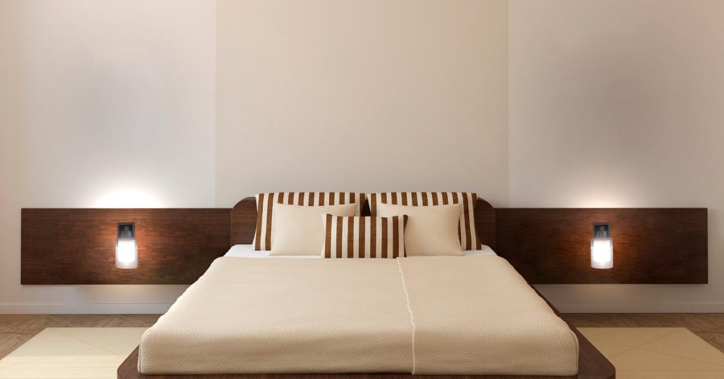 arandela em cabeceira de cama